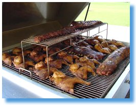 Chicken and ribs on the barbecue grill